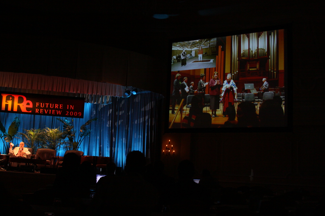 """""""Documenting Lushootseed, Through Its Last Living Speakers: A Foresight Foundation Project"""": Jay Miller, Vice President, Lushootseed Research; on-screen, a slide of the late Lushootseed Living Treasure Vi Hilbert, on the occasion of a symphony created and performed in her honor"""