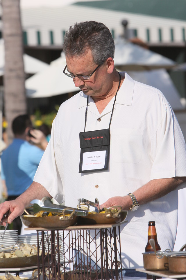 Mark Thiele, Dir. of Business Operations for R&D, VMware, samples reception cuisine