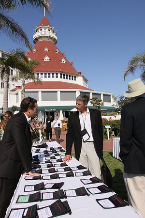 With the Del's famed Grand Ballroom turret in the background, guests are greeted at the Opening Reception: (L-R) Matt Keller, FiRe/Rodel Foundations interns, Thunderbird School of Global Management; Lewis Douglas, Managing Director, Ocean Alliance; and Roger Payne, Founder and President, Ocean Alliance