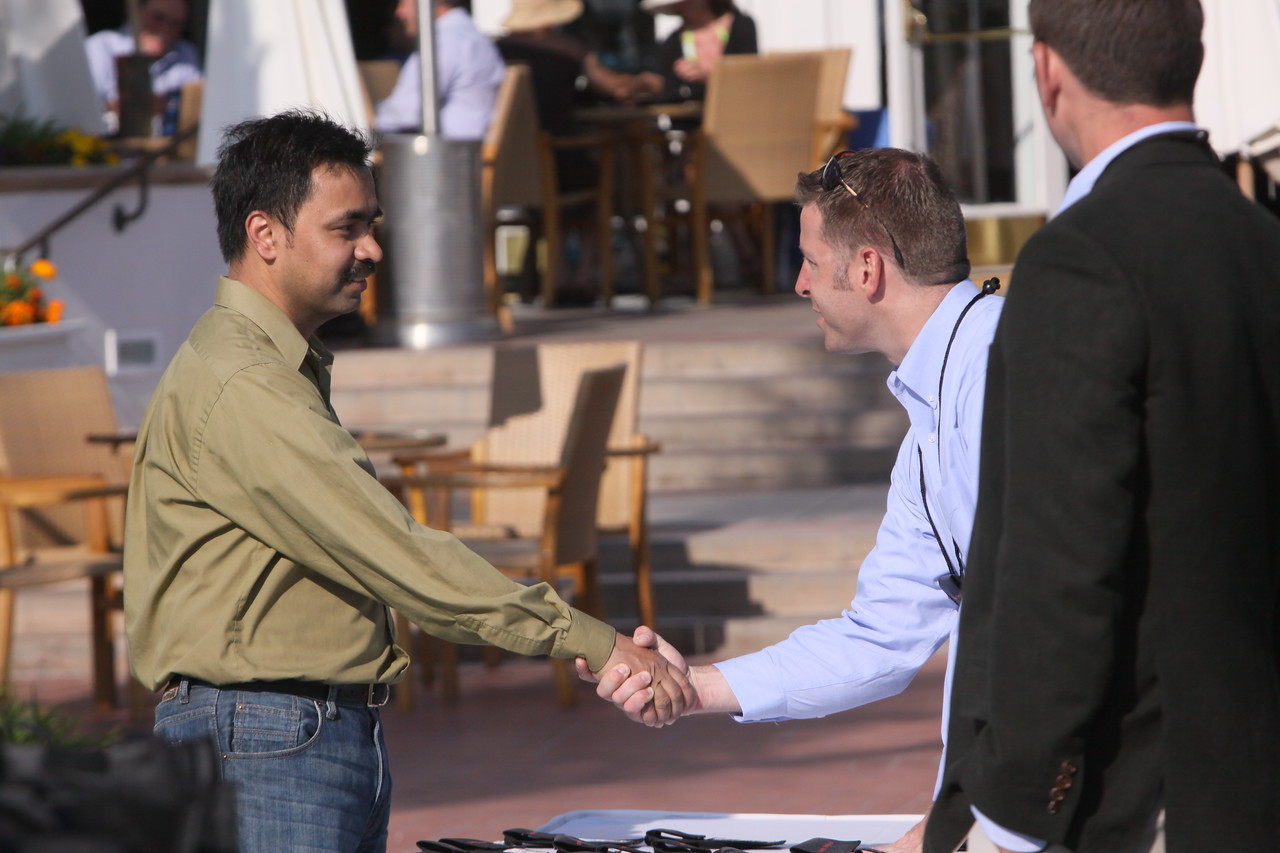Chetan Sharma, president of Chetan Sharma Consulting, is welcomed by FiRe staffer Brent Morris