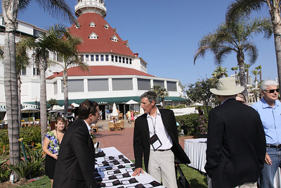 With the Del's famed Grand Ballroom turret in the background, guests are greeted at the Opening Reception: (L-R) Berit Anderson, FiRe Event Staff; Matt Keller, FiRe/Rodel Foundations interns, Thunderbird School of Global Management; Lewis Douglas, Managing Director, Ocean Alliance; Roger Payne, Founder and President, Ocean Alliance; and Randy Blotky, CEO, Technology Convergence Partners