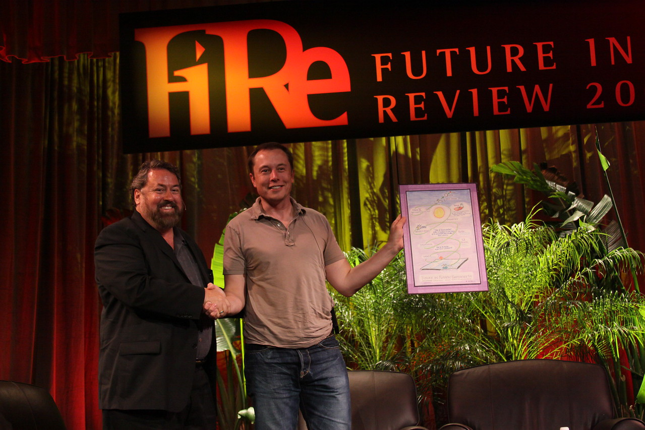 Mark Anderson presents Elon Musk, CEO of SpaceX and Tesla Motors, with the first FiRe Entrepreneur of the Year award (created by Joe Sterling, FiReScribe 2009)