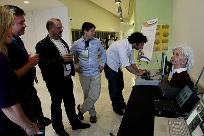 """Interactive Einstein"" demo on the FiRe tour of the Next-Generation Visualization and Networking Facilities (""FiRe Lab""), UCSD: (L-R) Kelly Ireland, Scott Gardner, Simon Hackett, and two of the many Calit2 wizards"