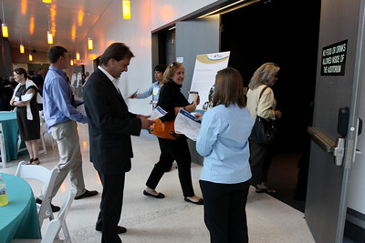 """FiRe tour of the Next-Generation Visualization and Networking Facilities (""""FiRe Lab""""), UCSD: (L-R) Adam Steinbrunner, Kai De Altin Popiolek, Kathy Hurley, and Sally Anderson file into the auditorium"""