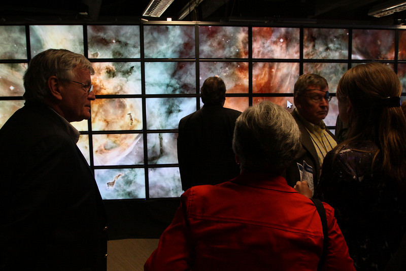 """FiRe tour of the Next-Generation Visualization and Networking Facilities (""""FiRe Lab""""), UCSD: (L-R) David Morris, Lynne Anderson, and Jerry Woodall"""