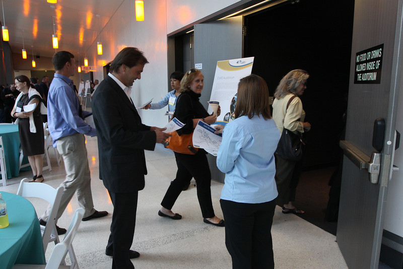"FiRe tour of the Next-Generation Visualization and Networking Facilities (""FiRe Lab""), UCSD: (L-R) Adam Steinbrunner, Kai De Altin Popiolek, Kathy Hurley, and Sally Anderson file into the auditorium"