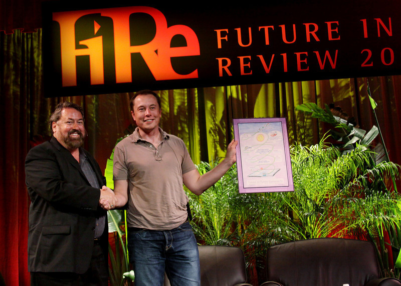 "Elon Musk (R), CEO of SpaceX and Tesla Motors, receives the first-ever ""FiRe Entrepreneur of the Year"" award from host Mark Anderson, FiRe Chair and CEO of SNS"