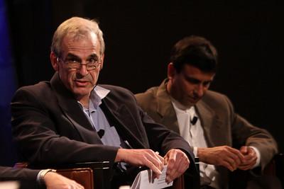 """The Future of Wireless Broadband"": Hugh Bradlow (L), CTO, Telstra; and Rama Shukla, Intel"