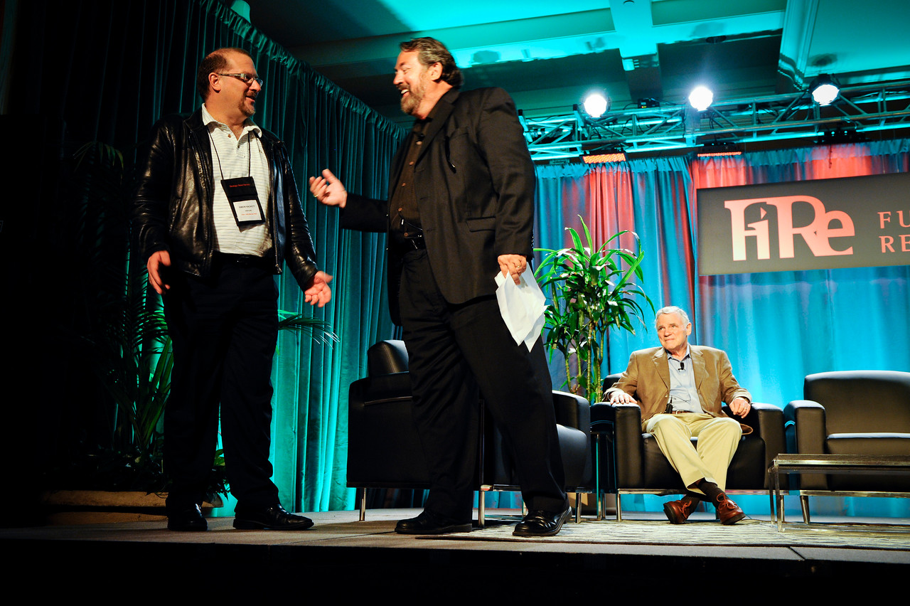 Mark Anderson (C) names Simon Hackett, Managing Director of Internode (Australia), FiRe 2011 Entrepreneur of the Year. Lee Hood is seated.