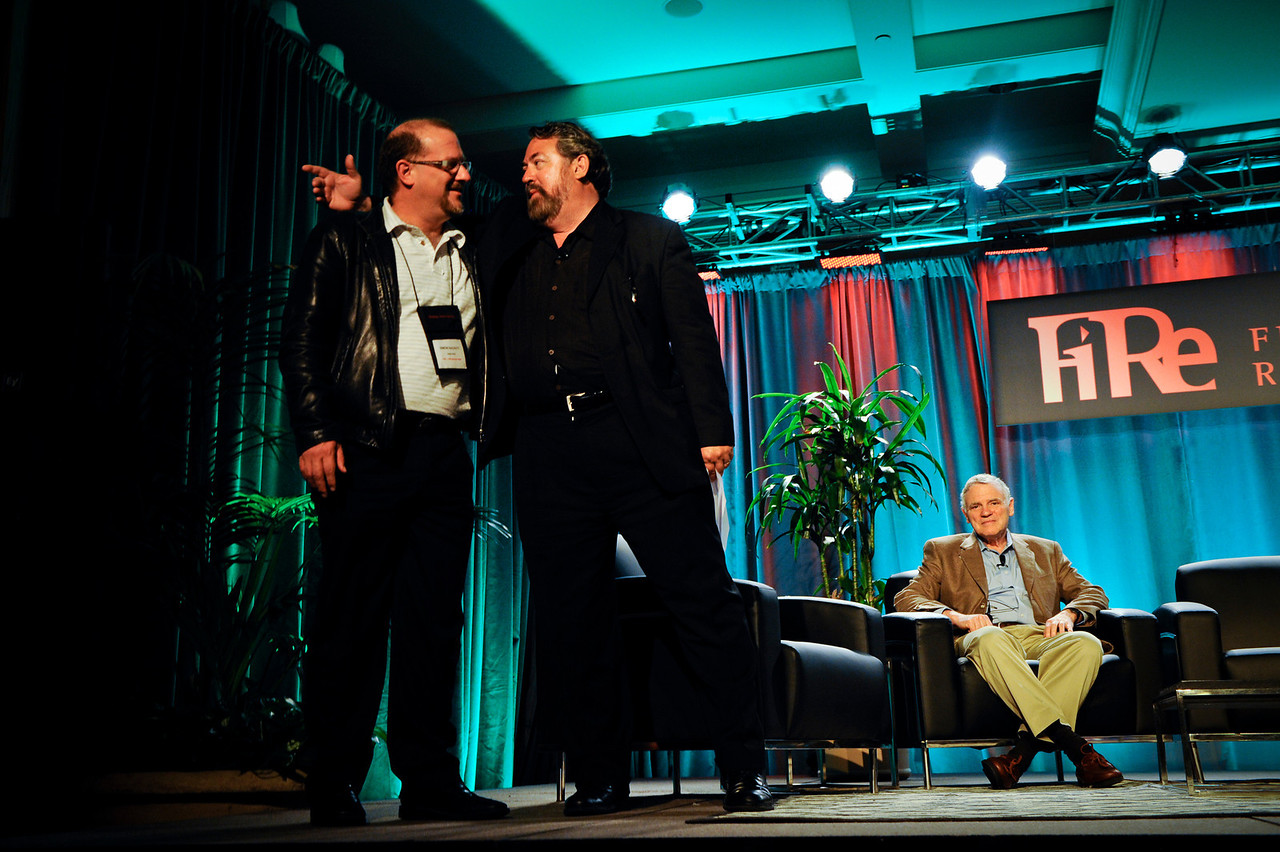 Mark Anderson (C) names Simon Hackett, Managing Director of Internode (Australia), FiRe 2011 Entrepreneur of the Year. Lee Hood is seated.  At the Montage Resort in Laguna Beach, CA, 200 thought leaders - high technology engineers and executives, entrepreneurs, scientists, and media professionals - gathered for 3-1/2 days to participate in the Future in Review (FiRe) 2011 conference presented by the Strategic News Service and led by SNS founder and technology visionary Mark Anderson. Interviews, panel discussions, and informal conversations ranged from cybersecurity to CO2 and climate change, China and IP, healthcare policy, medical diagnostics, and global economics.