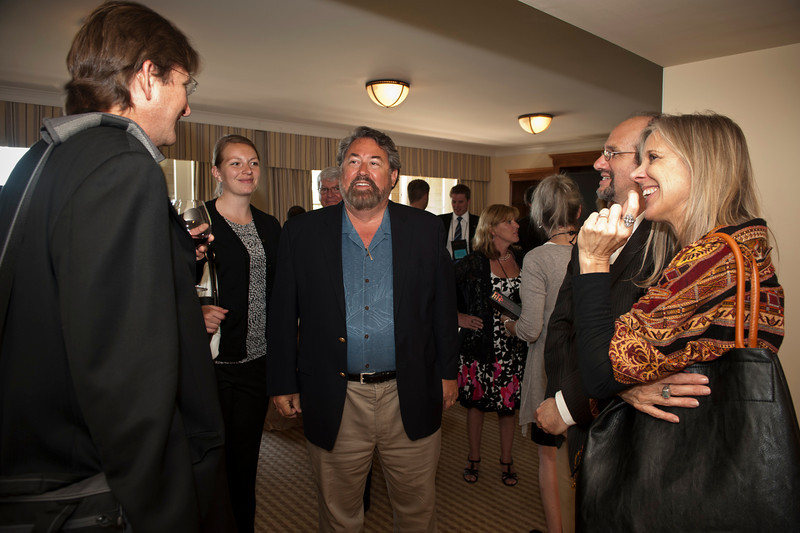 FiRe Chair Mark Anderson (center) and his assistant, Jenny Lee, discuss predictions with documentary filmmakers.   At the Montage Resort in Laguna Beach, CA, 200 thought leaders - high technology engineers and executives, entrepreneurs, scientists, and media professionals - gathered for 3-1/2 days to participate in the Future in Review (FiRe) 2011 conference presented by the Strategic News Service and led by SNS founder and technology visionary Mark Anderson. Interviews, panel discussions, and informal conversations ranged from cybersecurity to CO2 and climate change, China and IP, healthcare policy, medical diagnostics, and global economics.
