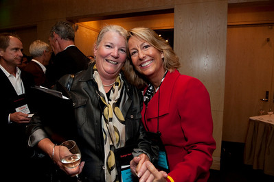 Kelly Webb (L), Assistant to the Programs Director, Strategic News Service; and Sharon Anderson-Morris, Programs Director, Strategic News Service