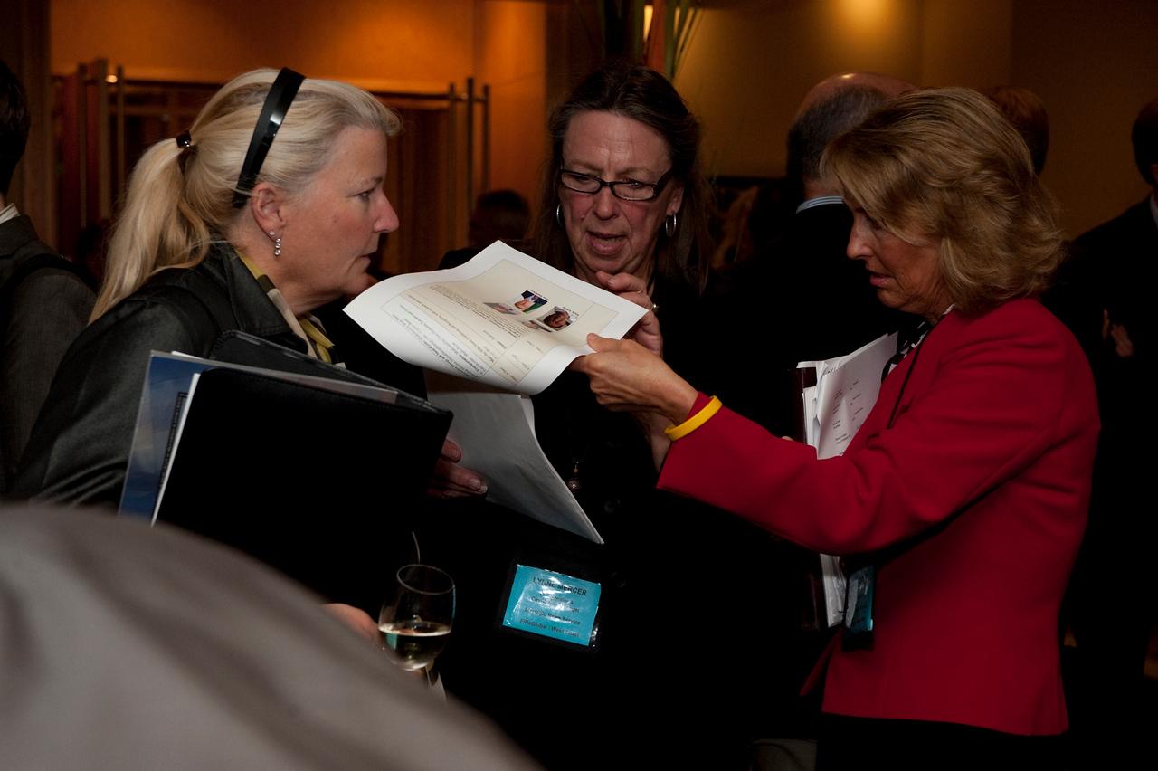 (L-R) Kelly Webb, Assistant to the Programs Director, Strategic News Service; Lynne Mercer, Comptroller, Strategic News Service; and Sharon Anderson-Morris, Programs Director, Strategic News Service