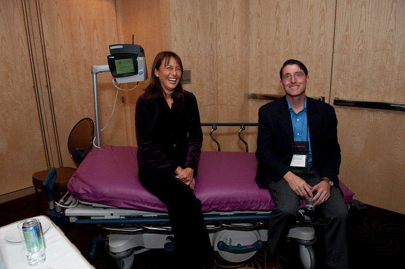 FiReStar Exhibition: Jan Sullivan (L), Hoana Medical Inc.; and Jud Virden, CTO, Pacific Northwest National Laboratory, enjoy a seat on Hoana's LifeBed Patient Vigilance System