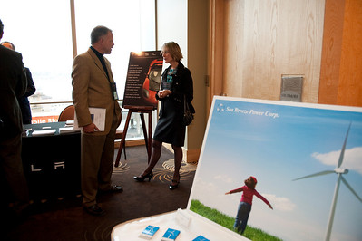 SNS event staffer Donald Murray discusses FiReStar company CytomX Therapeutics with CEO Nancy Stagliano; in the foreground is FiReStar Sea Breeze Power Corp.'s display