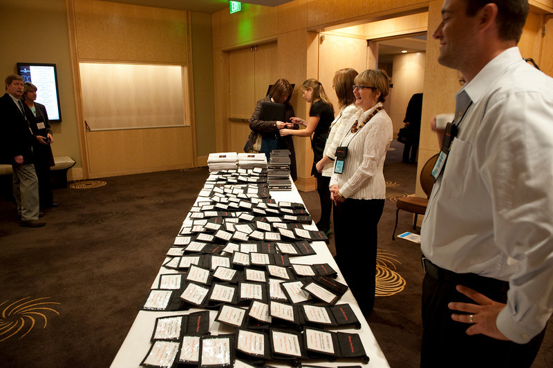 SNS event staffers stand ready for early registration to begin.