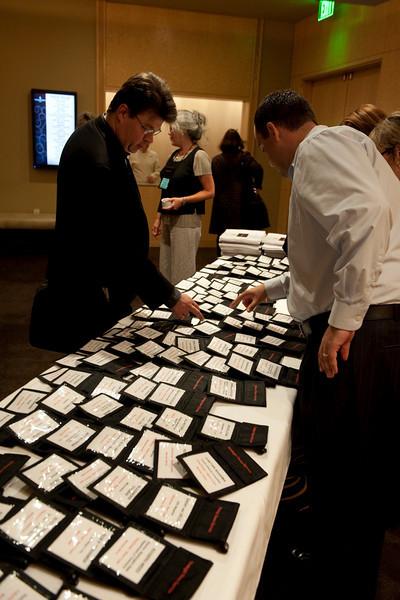 SNS event staffer Gustav Toppenberg helps Robert Kruse, Managing Partner of VenLogic, with conference materials