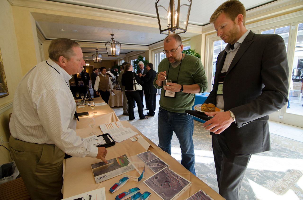 FiReStarters Exhibition: Steve Cooper (L) and Davis Brimer (R) describe Active Life Scientific to Vaclav Vincalek, President, Pacific Coast Information Systems.  May 22-25, 2012: At the Montage in Laguna Beach, CA, 200 thought leaders - high technology engineers and executives, entrepreneurs, scientists, and media professionals - gathered for 3 days to participate in FiRe X, the 10th annual Future in Review conference, presented by the Strategic News Service and led by SNS founder and technology visionary Mark Anderson. Interviews, panel discussions, and informal conversations ranged from IP protection to CO2 and climate change, new healthcare paradigms, global economics, ocean toxins, robotics, documentary filmmaking,  medical diagnostics, technology solutions for social issues, global economics, mobile computing, and tech solutions to human trafficking and aging with dignity.