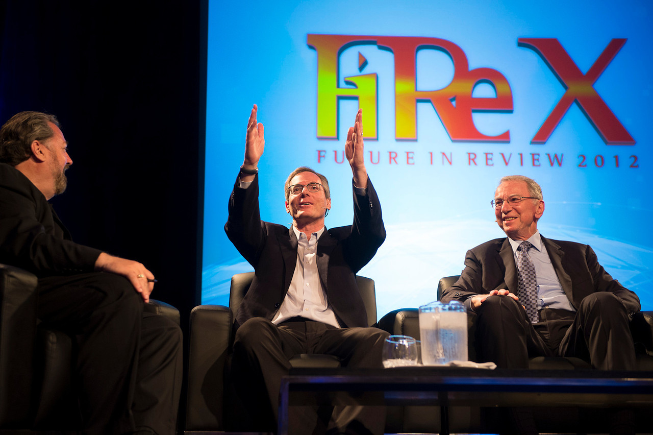 "Host Mark Anderson (L), Qualcomm Chairman Paul Jacobs, and Qualcomm Chairman Emeritus Irwin Jacobs, in the Centerpiece Conversation ""The Future of Wireless.""  May 22-25, 2012: At the Montage in Laguna Beach, CA, 200 thought leaders - high technology engineers and executives, entrepreneurs, scientists, and media professionals - gathered for 3 days to participate in FiRe X, the 10th annual Future in Review conference, presented by the Strategic News Service and led by SNS founder and technology visionary Mark Anderson. Interviews, panel discussions, and informal conversations ranged from IP protection to CO2 and climate change, new healthcare paradigms, global economics, ocean toxins, robotics, documentary filmmaking,  medical diagnostics, technology solutions for social issues, global economics, mobile computing, and tech solutions to human trafficking and aging with dignity."