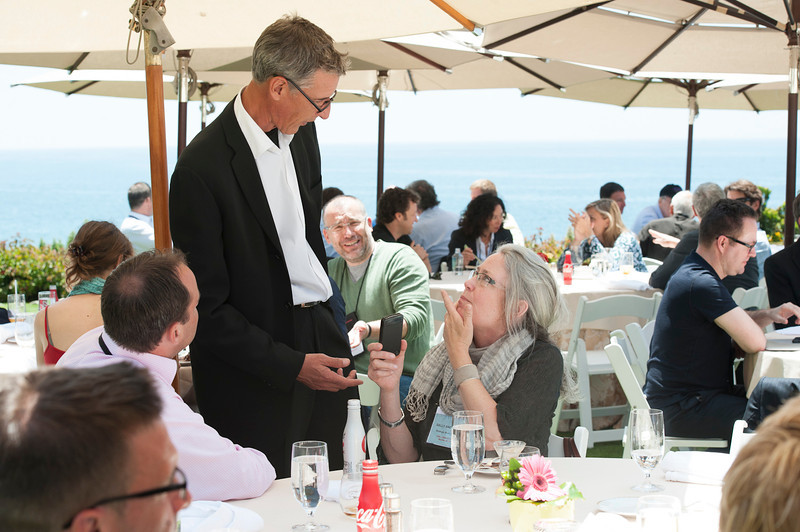 Lew Douglas (standing), Co-Founder, Urth Organic; and Sally Anderson.  May 22-25, 2012: At the Montage in Laguna Beach, CA, 200 thought leaders - high technology engineers and executives, entrepreneurs, scientists, and media professionals - gathered for 3 days to participate in FiRe X, the 10th annual Future in Review conference, presented by the Strategic News Service and led by SNS founder and technology visionary Mark Anderson. Interviews, panel discussions, and informal conversations ranged from IP protection to CO2 and climate change, new healthcare paradigms, global economics, ocean toxins, robotics, documentary filmmaking,  medical diagnostics, technology solutions for social issues, global economics, mobile computing, and tech solutions to human trafficking and aging with dignity.
