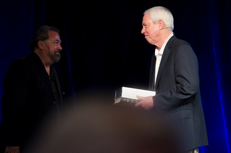 """Mark Anderson (L) presents Don Budinger, Chairman and Founding Director of The Rodel Foundations, with the FiRe X """"Philanthropist of the Year"""" award.  May 22-25, 2012: At the Montage in Laguna Beach, CA, 200 thought leaders - high technology engineers and executives, entrepreneurs, scientists, and media professionals - gathered for 3 days to participate in FiRe X, the 10th annual Future in Review conference, presented by the Strategic News Service and led by SNS founder and technology visionary Mark Anderson. Interviews, panel discussions, and informal conversations ranged from IP protection to CO2 and climate change, new healthcare paradigms, global economics, ocean toxins, robotics, documentary filmmaking,  medical diagnostics, technology solutions for social issues, global economics, mobile computing, and tech solutions to human trafficking and aging with dignity."""