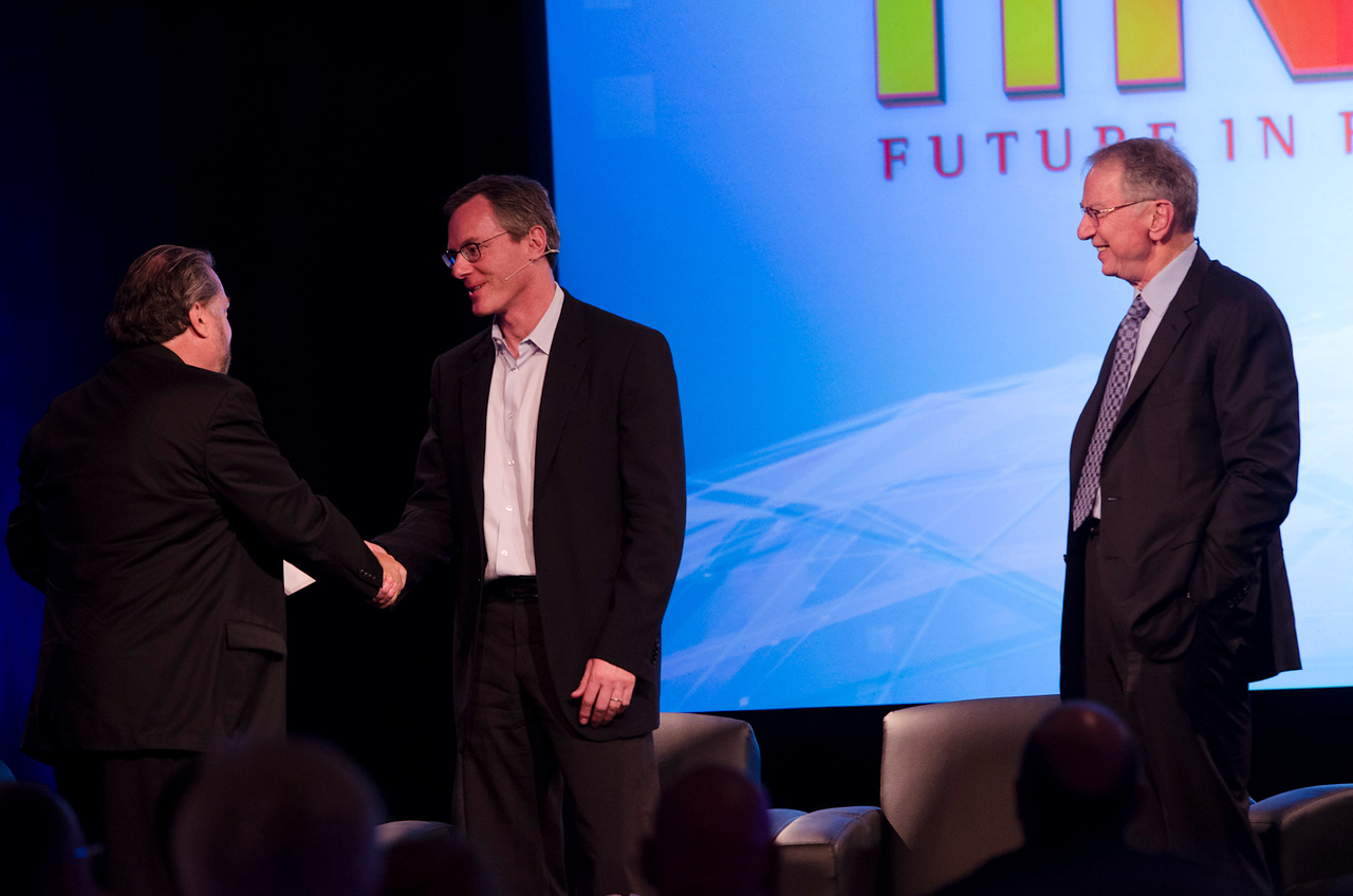 "Host Mark Anderson (L) presents Qualcomm Chairman Paul Jacobs with the FiRe ""CEO of the Year"" award while Chairman Emeritus Irwin Jacobs looks on.   May 22-25, 2012: At the Montage in Laguna Beach, CA, 200 thought leaders - high technology engineers and executives, entrepreneurs, scientists, and media professionals - gathered for 3 days to participate in FiRe X, the 10th annual Future in Review conference, presented by the Strategic News Service and led by SNS founder and technology visionary Mark Anderson. Interviews, panel discussions, and informal conversations ranged from IP protection to CO2 and climate change, new healthcare paradigms, global economics, ocean toxins, robotics, documentary filmmaking,  medical diagnostics, technology solutions for social issues, global economics, mobile computing, and tech solutions to human trafficking and aging with dignity."