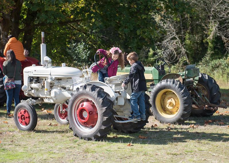 Kids enjoying the tractors on display