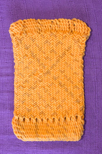 Sprang pouch with 3-3 interlacing. Simple interlinking at top and bottom.