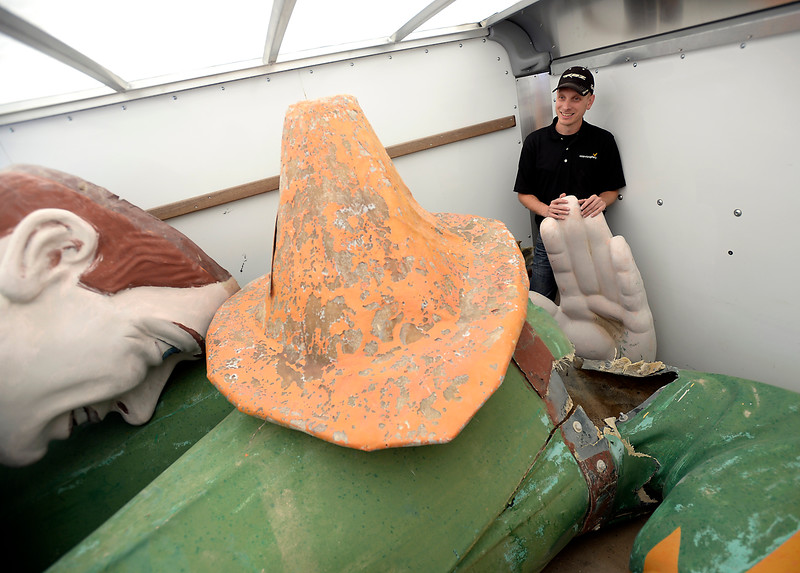 Standing in a moving truck that holds pieces of a Texaco Big Friend, Joel Baker of Loveland talks Thursday, Oct. 13, 2016, about his plans to restore the fiberglass giant. Baker is one of the leading restorers of large 1960s and 1970s Fiberglass figures, like the Muffler men. (Photo by Jenny Sparks/Loveland Reporter-Herald)
