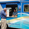 Fidelity Bank employee Steve Shimkus mans the company ice cream truck offering up free ice cream compliments on Fidelity Bank on Thursday afternoon. SENTINEL & ENTERPRISE / Ashley Green
