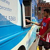 Errickson Danger, 12, scoops up some free ice cream compliments on Fidelity Bank on Thursday afternoon in Fitchburg. SENTINEL & ENTERPRISE / Ashley Green