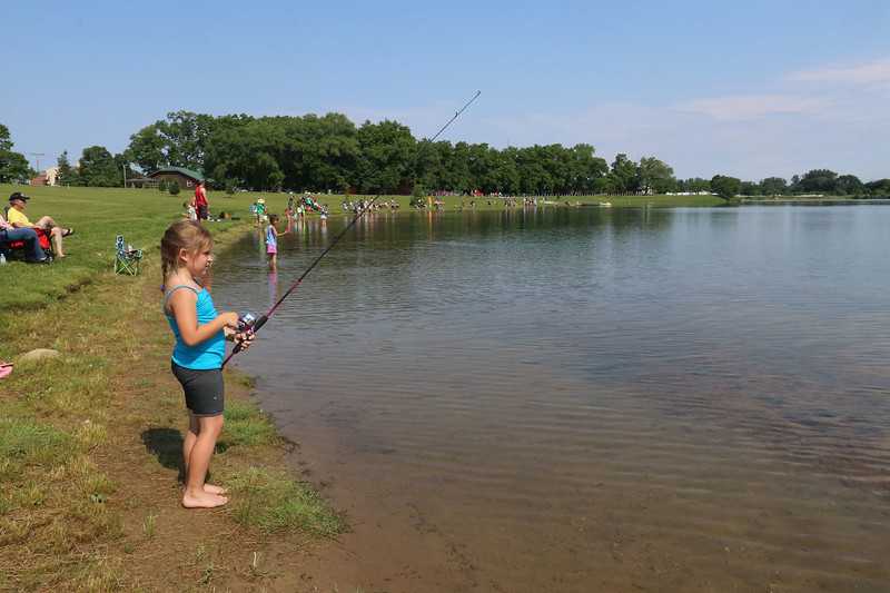 Roger Schneider| The Goshen News Grace Keene, 7, of Goshen, waits for a fish to bite during Saturday's fishing tournament at Goshen's Fidler Pond Park.