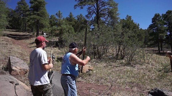 We shot an arrow into the air. Hopefully it went over the tree so we could pull the antenna up.
