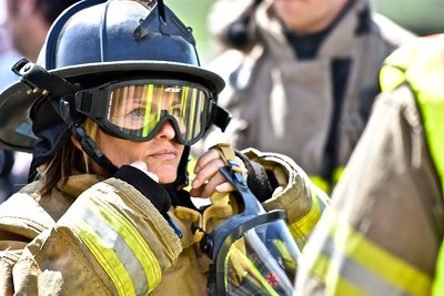 Eureka City Council member Kim Bergel tightens her fire helmet before putting on her oxygen mask. (Jose Quezada - For the Times-Standard)