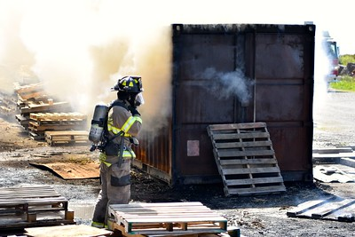 Trainees enter this smoldering iron container especially designed to emulate a burning structure with heavy smoke and fire. (Jose Quezada - For the Times-Standard)