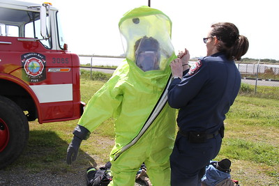 A Humboldt Bay firefighter suits up for a Haz-Mat response demonstration. (Manny Araujo - Times-Standard)
