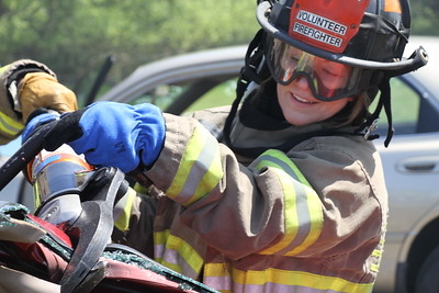 Eureka City Councilmember Heidi Messner tears at the roof of a car with a pair of Hydraulic sheers. Messner said she was glad she got a chance to see the work the firefighters regularly encounter. (Manny Araujo - Times-Standard)