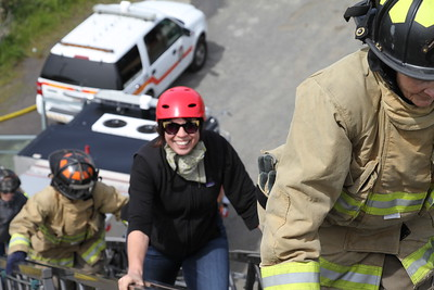 Eureka City Councilmember Natalie Arroyo climbs up a fire truck ladder. (Manny Araujo - Times-Standard)