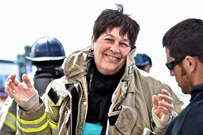Eureka city Council member Marian Brady lets a Humbodlt Bay Fire trainer check her gear. (Jose Quezada - For the Times-Standard)