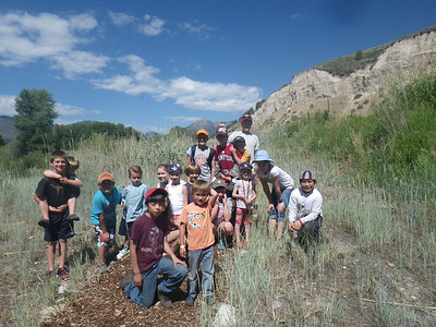 Thursday: Today we teamed up with another day program group to do some community service at the Conservation Research Center. We worked with the 5th/6th grade group to build a trail. In the afternoon we drove out to the Gros Ventre River where we explored in the water. We are excited to share what we have learned with our friends and family tomorrow! Follow-up Question: What is community service?