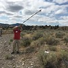 """Participant, Michael Bunds (Utah Valley University), uses a camera on a pole to survery stream bed topography using SfM. North Boulder Creek near Cardwell, Montana.<br /> From short course held at Indiana University Geologic Field Station August 16-19 2016. Short course title: Using TLS and Structure from Motion (SfM) Photogrammetry in Undergraduate Field Education. <a href=""""http://www.unavco.org/education/advancing-geodetic-skills/short-courses/2016/field-education/field-education.html"""">http://www.unavco.org/education/advancing-geodetic-skills/short-courses/2016/field-education/field-education.html</a>"""