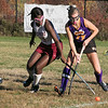 Montachusett Regional Vocational Technical School field hockey played Fitchburg High School on Thursday afternoon, Oct. 24, 2019. Fighting for control of the ball is FHS's Olamide Bamgbose and Monty Tech's #17 Maddy McCaie. SENTINEL & ENTERPRISE/JOHN LOVE