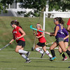North Middlesex player Shelley Lielasus takes off with the ball during action in thier match up against Groton. SENTINEL & ENTERPRISE/JOHN LOVE