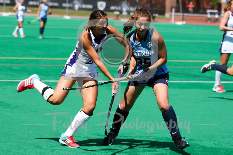 Holy Cross midfielder Grace Spirk (2) Columbia midfielder Whitney Hartstone (25)