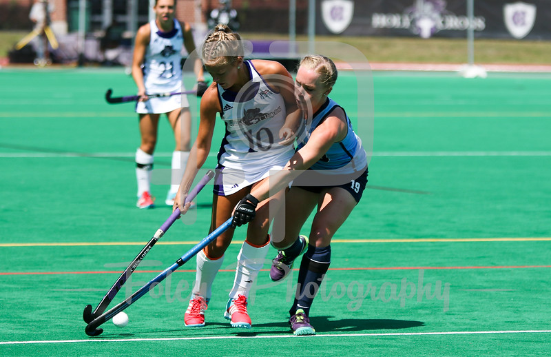 Holy Cross midfielder Lauren Sutherland (10) Columbia midfielder Meredith Kalberer (19)
