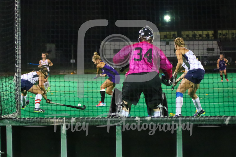 Holy Cross midfielder Lauren Sutherland (10) Quinnipiac goalkeeper Hannah Teicher (34)