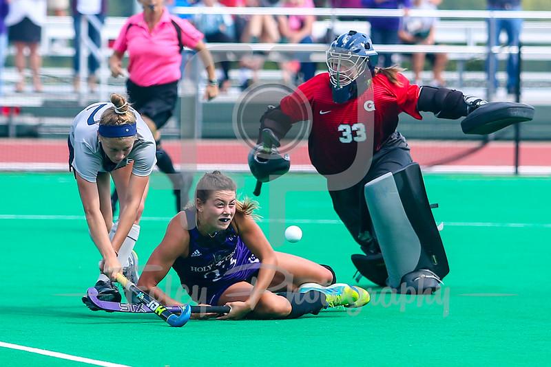 Georgetown Hoyas midfielder Anna Farley (22) Holy Cross Crusaders forward Suzanne Noone (23) Georgetown Hoyas goalkeeper Chloe Verwiel (33)