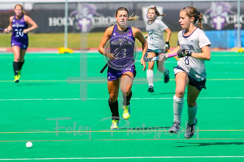 Holy Cross Crusaders forward Suzanne Noone (23) Holy Cross Crusaders midfielder Rachel Lapar (8)