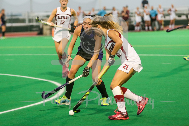 Harvard Crimson midfielder Olivia Ostover (21) Holy Cross Crusaders forward Danielle McAdam (13)