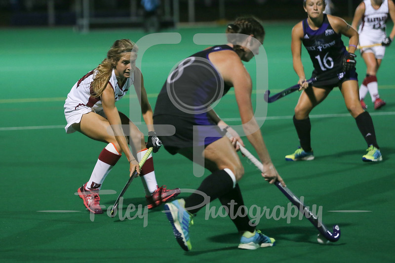 Holy Cross Crusaders midfielder Rachel Lapar (8) Harvard Crimson midfielder Olivia Ostover (21)